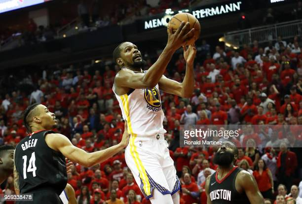Kevin Durant of the Golden State Warriors shoots against Gerald Green and James Harden of the Houston Rockets in the third quarter of Game Two of the...