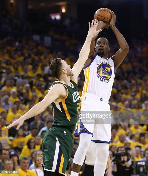 Kevin Durant of the Golden State Warriors shoots against Gordon Hayward of the Utah Jazz during Game One of the NBA Western Conference SemiFinals at...