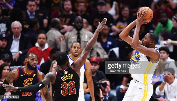 Kevin Durant of the Golden State Warriors shoots against Jeff Green of the Cleveland Cavaliers during Game Three of the 2018 NBA Finals at Quicken...