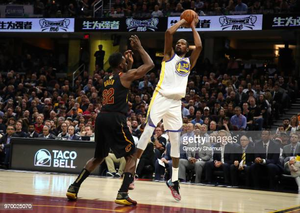 Kevin Durant of the Golden State Warriors shoots against Jeff Green of the Cleveland Cavaliers in the first quarter during Game Four of the 2018 NBA...