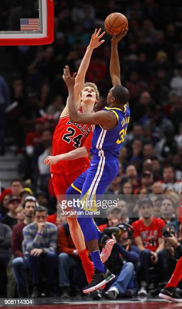 Kevin Durant of the Golden State Warriors shoots against Lauri Markkanen of the Chicago BuJerian Grant of the Chicago Bulls at the United Center on...