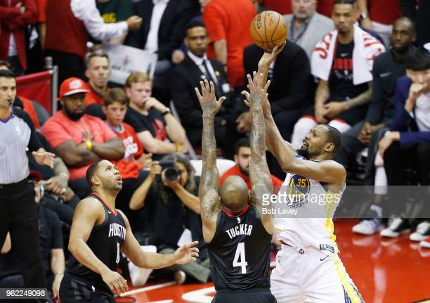 Kevin Durant of the Golden State Warriors shoots against PJ Tucker of the Houston Rockets in the second half of Game Five of the Western Conference...