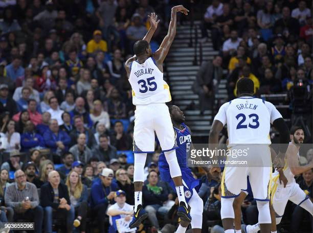 Kevin Durant of the Golden State Warriors shoots and scores over Montrezl Harrell of the LA Clippers during the first half of their NBA Basketball...