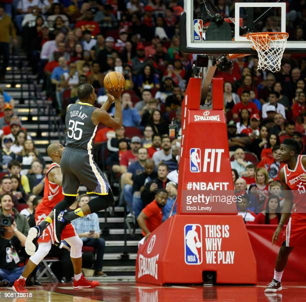 Kevin Durant of the Golden State Warriors shoots in the firsdt quarter against the Houston Rockets at Toyota Center on January 20 2018 in Houston...