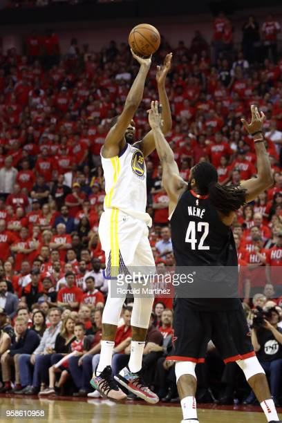 Kevin Durant of the Golden State Warriors shoots in the second half against Nene Hilario of the Houston Rockets in Game One of the Western Conference...