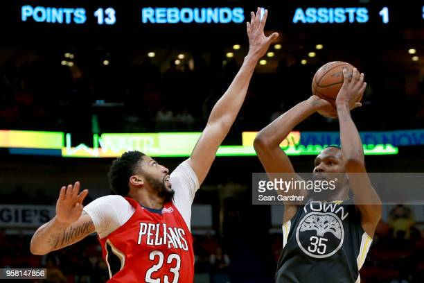 Kevin Durant of the Golden State Warriors shoots over Anthony Davis of the New Orleans Pelicans during Game Four of the Western Conference Semifinals...