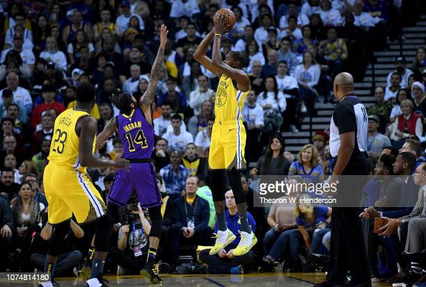 Kevin Durant of the Golden State Warriors shoots over Brandon Ingram of the Los Angeles Lakers during the first half of their NBA Basketball game at...
