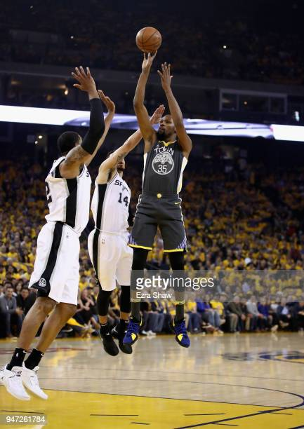 Kevin Durant of the Golden State Warriors shoots over Danny Green of the San Antonio Spurs during Game 2 of Round 1 of the 2018 NBA Playoffs at...