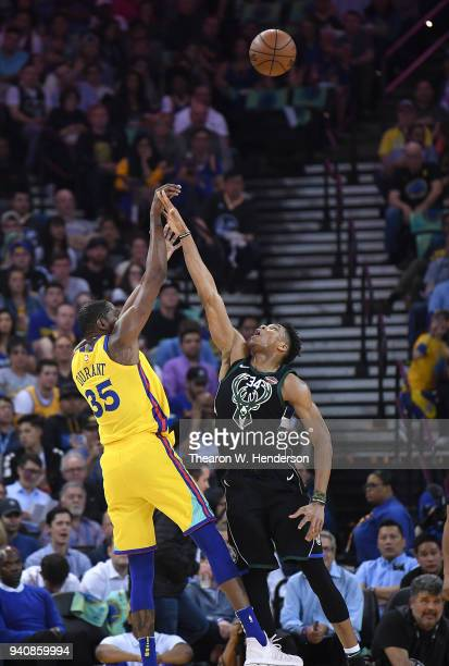Kevin Durant of the Golden State Warriors shoots over Giannis Antetokounmpo of the Milwaukee Bucks during an NBA basketball game at ORACLE Arena on...