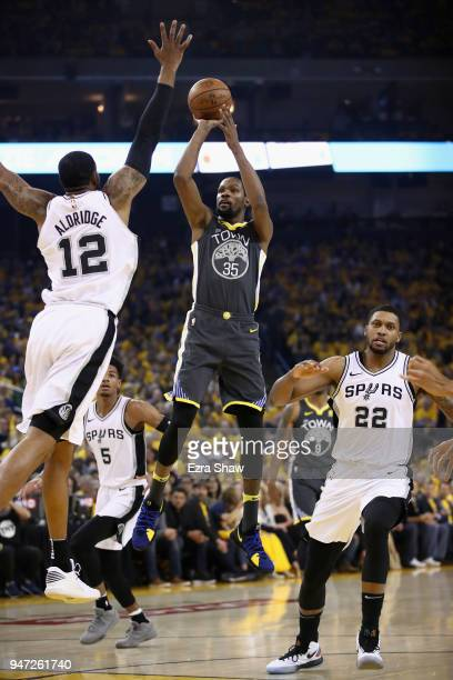 Kevin Durant of the Golden State Warriors shoots over LaMarcus Aldridge of the San Antonio Spurs during Game 2 of Round 1 of the 2018 NBA Playoffs at...