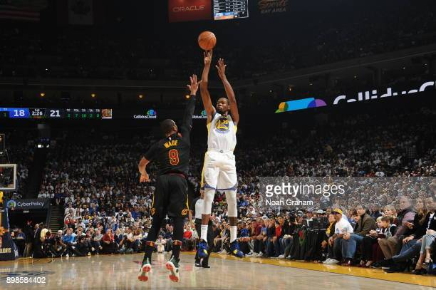 Kevin Durant of the Golden State Warriors shoots the ball against Dwyane Wade of the Cleveland Cavaliers on December 25 2017 at ORACLE Arena in...