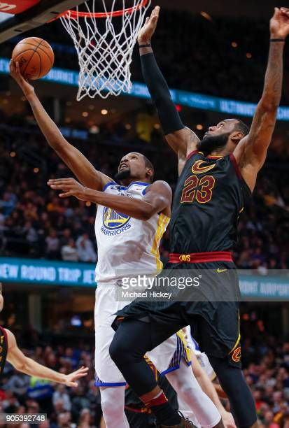Kevin Durant of the Golden State Warriors shoots the ball against LeBron James of the Cleveland Cavaliers at Quicken Loans Arena on January 15 2018...