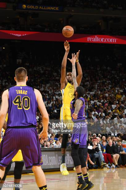 Kevin Durant of the Golden State Warriors shoots the ball against the Los Angeles Lakers on December 25 2018 at ORACLE Arena in Oakland California...