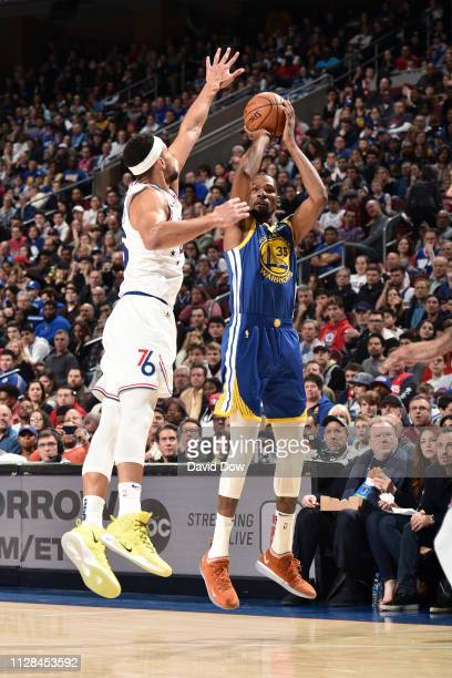 Kevin Durant of the Golden State Warriors shoots the ball against the Philadelphia 76ers on March 2 2019 at the Wells Fargo Center in Philadelphia...
