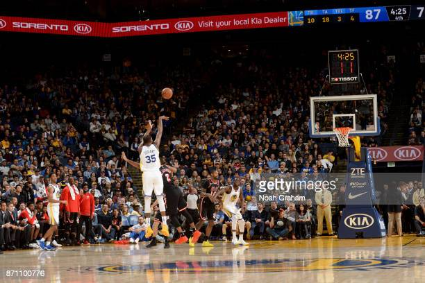 Kevin Durant of the Golden State Warriors shoots the ball against the Miami Heat on November 6 2017 at ORACLE Arena in Oakland California NOTE TO...