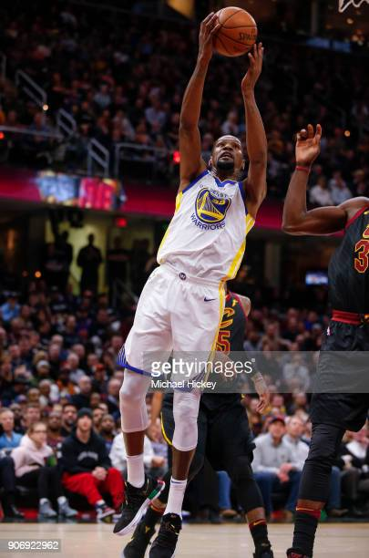 Kevin Durant of the Golden State Warriors shoots the ball against the Cleveland Cavaliers at Quicken Loans Arena on January 15 2018 in Cleveland Ohio...