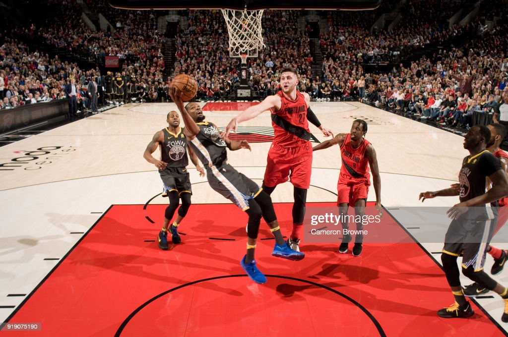 Kevin Durant #35 of the Golden State Warriors shoots the ball against the Portland Trail Blazers on February 14, 2018 at the Moda Center Arena in Portland, Oregon.