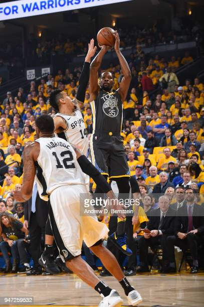 Kevin Durant of the Golden State Warriors shoots the ball against the San Antonio Spurs in Game Two of Round One of the 2018 NBA Playoffs on April 16...