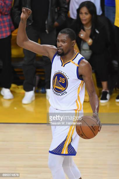 Kevin Durant of the Golden State Warriors signals in Game 5 of the 2017 NBA Finals against the Cleveland Cavaliers at ORACLE Arena on June 12 2017 in...