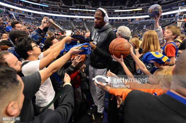 Kevin Durant of the Golden State Warriors signs autographs before the game against the Denver Nuggets on February 13 2017 at the Pepsi Center in...