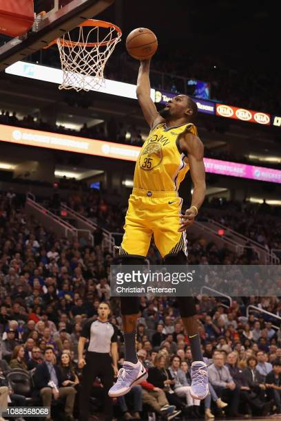 Kevin Durant of the Golden State Warriors slam dunks the ball against the Phoenix Suns during the first half of the NBA game at Talking Stick Resort...