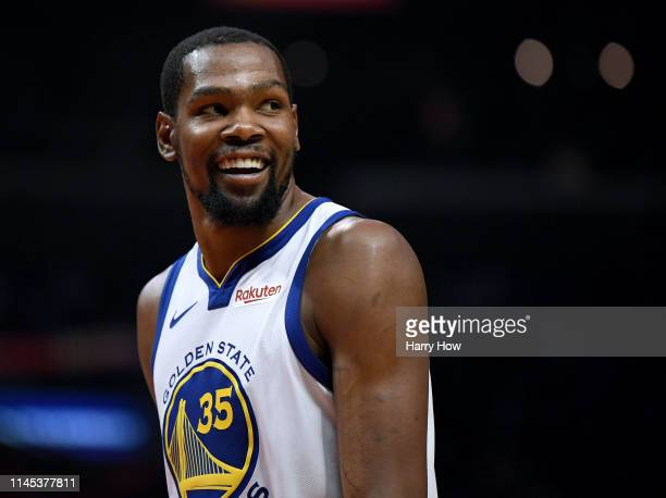 2684347fd42 Kevin Durant of the Golden State Warriors smiles at his bench in a 129110  win over