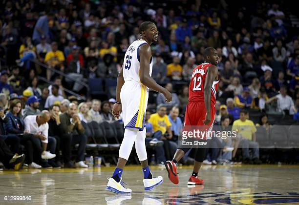 Kevin Durant of the Golden State Warriors smiles during their game against the Los Angeles Clippers during their preseason game at ORACLE Arena on...