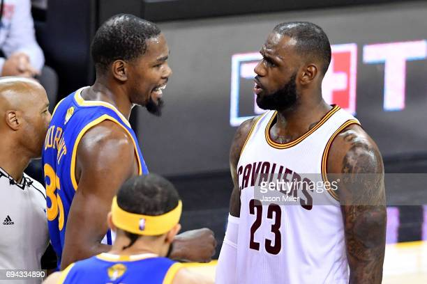 Kevin Durant of the Golden State Warriors speaks to LeBron James of the Cleveland Cavaliers in the first quarter in Game 4 of the 2017 NBA Finals at...