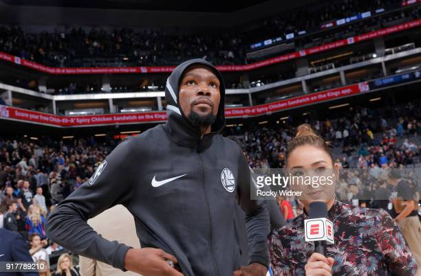 Kevin Durant of the Golden State Warriors speaks with Cassidy Hubbarth after defeating the Sacramento Kings on February 2 2018 at Golden 1 Center in...