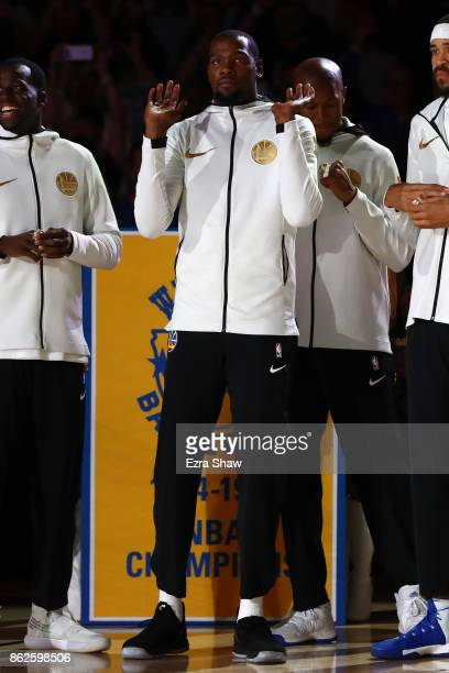 Kevin Durant of the Golden State Warriors stands during their 2017 NBA Championship ring ceremony prior to their NBA game against the Houston Rockets...