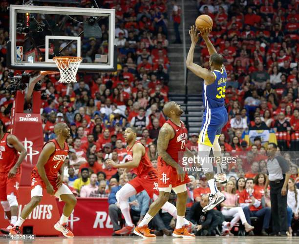 Kevin Durant of the Golden State Warriors takes a three point shot defended by PJ Tucker of the Houston Rockets in the first half during Game Three...