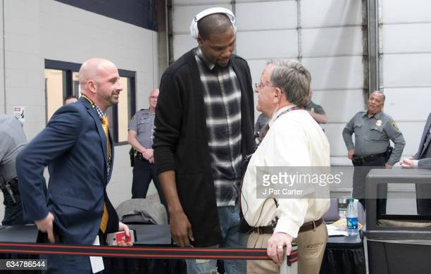 Kevin Durant of the Golden State Warriors talks to game officials as he arrives at the Chesapeake Energy Arena for a NBA game against the Oklahoma...