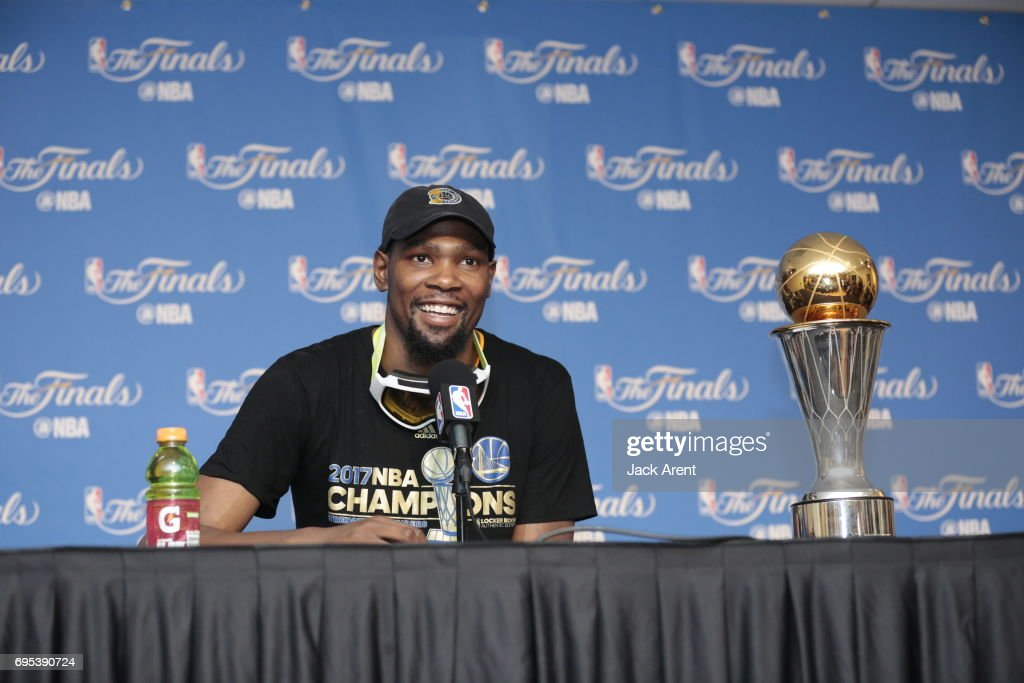 Kevin Durant #35 of the Golden State Warriors talks to the media after winning the NBA Championship against the Golden State Warriors in Game Five of the 2017 NBA Finals on June 12, 2017 at ORACLE Arena in Oakland, California.