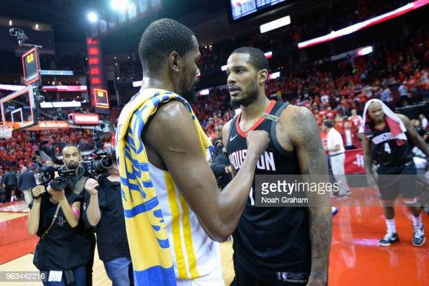 Kevin Durant of the Golden State Warriors talks to Trevor Ariza of the Houston Rockets after Game Seven of the Western Conference Finals during the...