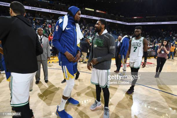 Kevin Durant of the Golden State Warriors talks with Kyrie Irving of the Boston Celtics after the game on March 5 2019 at ORACLE Arena in Oakland...