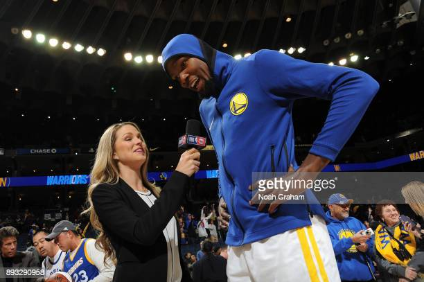 Kevin Durant of the Golden State Warriors talks with media after the game against the Dallas Mavericks on December 14 2017 at ORACLE Arena in Oakland...