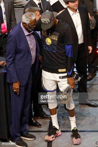 Kevin Durant of the Golden State Warriors talks with NBA Legend Bill Russell hand after winning the Bill Russell Finals MVP Trophy in Game Four of...