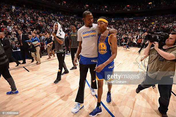 Kevin Durant of the Golden State Warriors talks with Patrick McCaw of the Golden State Warriors after a preseason game against the Toronto Raptors on...