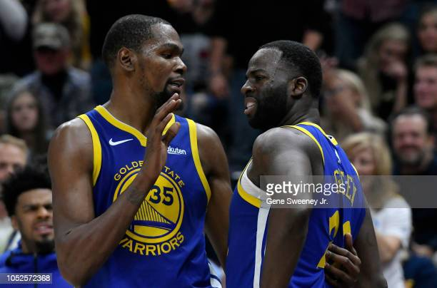 Kevin Durant of the Golden State Warriors tries to calm down teammate Draymond Green after a foul in the second half of a NBA game against the Utah...