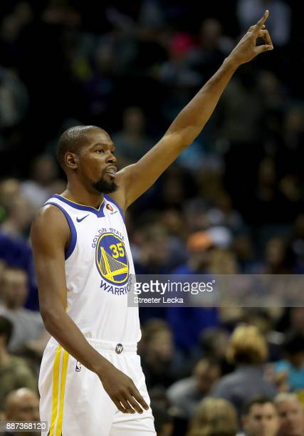 Kevin Durant of the Golden State Warriors walks onto the court against the Charlotte Hornets before their game at Spectrum Center on December 6 2017...