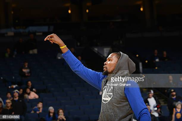 Kevin Durant of the Golden State Warriors warms up before a game against the Miami Heat on January 10 2017 at ORACLE Arena in Oakland California NOTE...