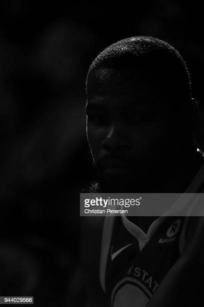 Kevin Durant of the Golden State Warriors watches from the bench during the first half of the NBA game against the Phoenix Suns at Talking Stick...