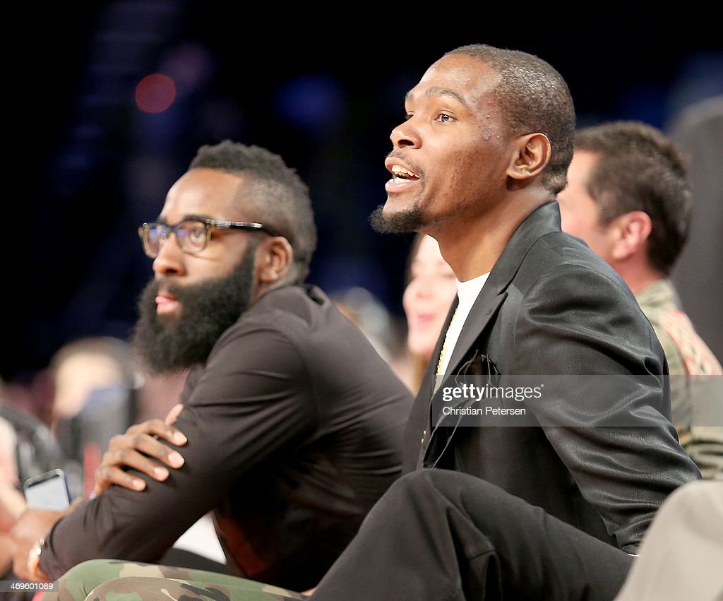 Kevin Durant of the Oklahoma City Thunder and James Harden of the Houston Rockets watch the BBVA Compass Rising Stars Challenge 2014 as part of the 2014 NBA Allstar Weekend at the Smoothie King Center on February 14, 2014 in New Orleans, Louisiana.