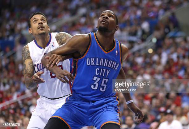 Kevin Durant of the Oklahoma City Thunder and Matt Barnes of the Los Angeles Clippers fight for position under the boards in Game Four of the Western...