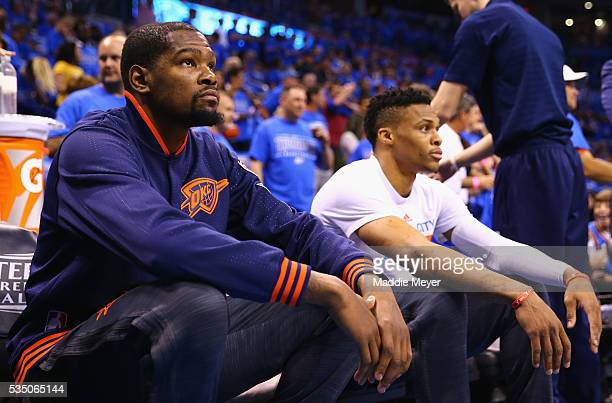 Kevin Durant of the Oklahoma City Thunder and Russell Westbrook look on prior to game six of the Western Conference Finals against the Golden State...