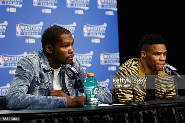 Kevin Durant of the Oklahoma City Thunder and Russell Westbrook look on during a press conference after the Golden State Warriors defeated the...