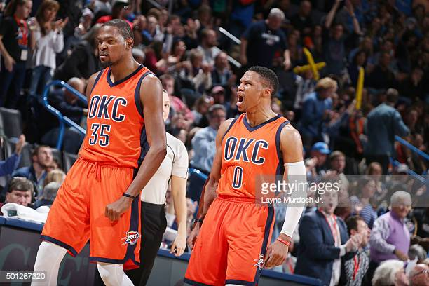 Kevin Durant of the Oklahoma City Thunder and Russell Westbrook of the Oklahoma City Thunder celebrate during the game against the Utah Jazz on...