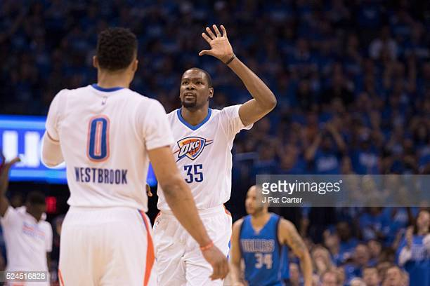 Kevin Durant of the Oklahoma City Thunder and Russell Westbrook of the Oklahoma City Thunder celebrate after defeating the Dallas Mavericks during...