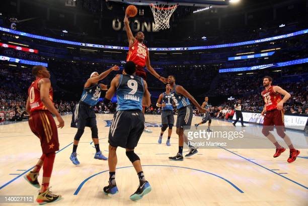 Kevin Durant of the Oklahoma City Thunder and the Western Conference dunks against Andre Iguodala of the Philadelphia 76ers and the Eastern...