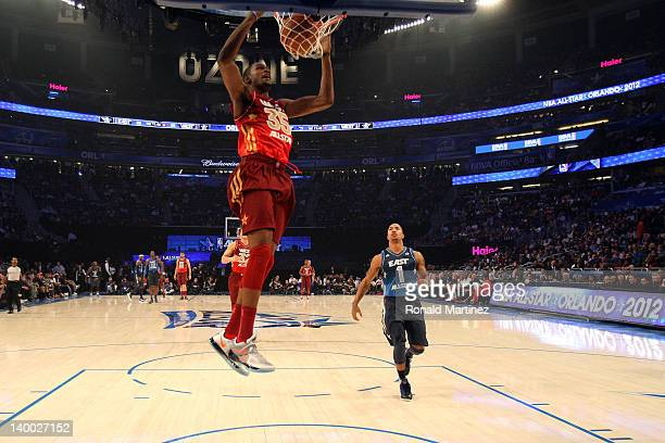 Kevin Durant of the Oklahoma City Thunder and the Western Conference dunks against Derrick Rose of the Chicago Bulls and the Eastern Conference...